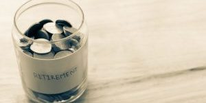 Concept business finance retirement save money. Cash in jar and word retirement